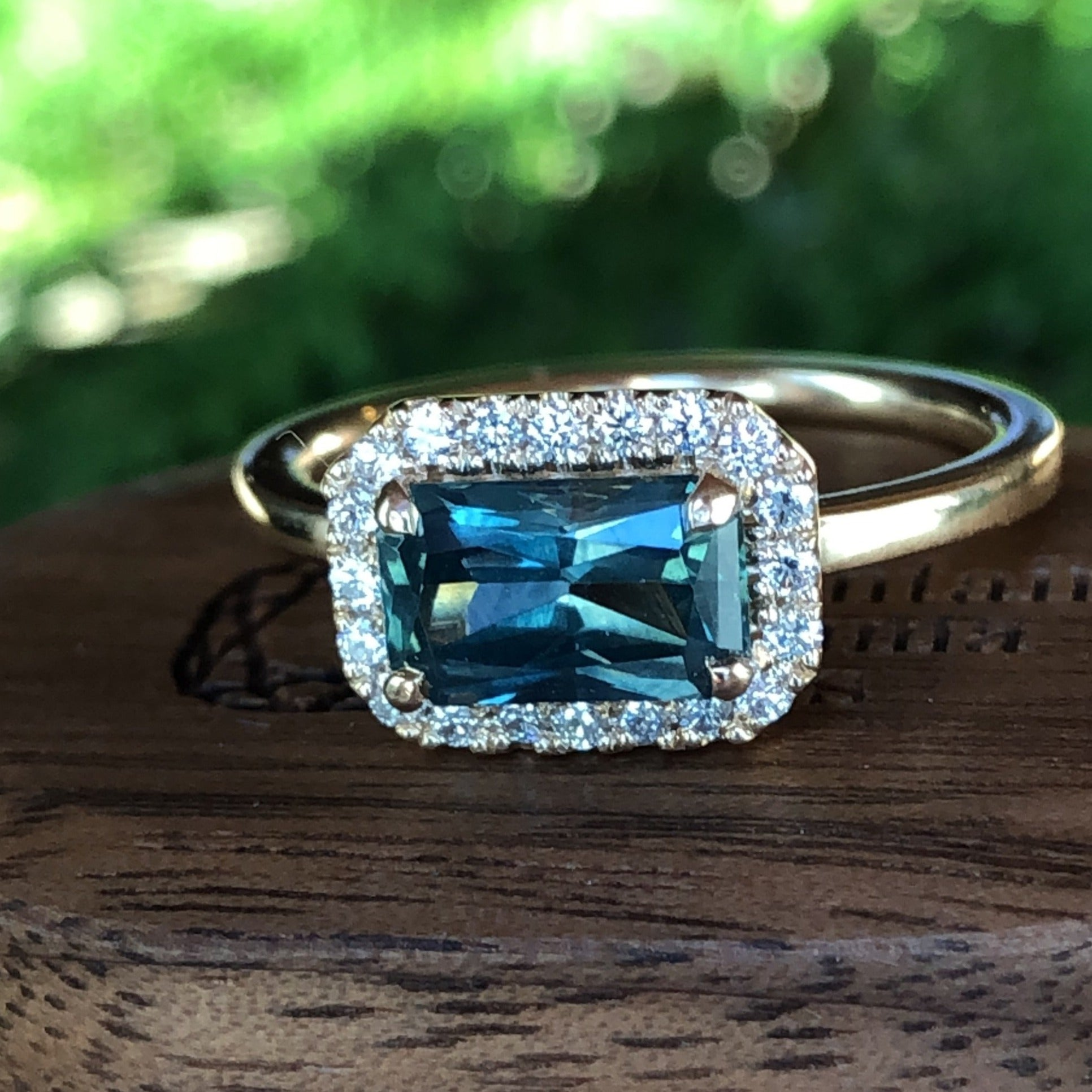 Montana Sapphire and Diamond Halo East/West Teal Radiant cut 1.54 carat 14k Yellow Gold Engagement Ring