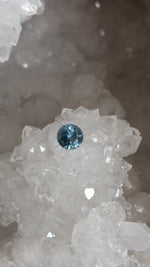 Load image into Gallery viewer, Montana Sapphire 0.87 Ct Light Blue and Silver Round Brilliant Cut