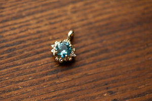 Montana Sapphire .79 carat and Diamond Scroll Pendant