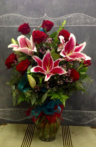 1 dozen long stem red roses and pink stargazer lilies designed by local florist clovis ca delivery