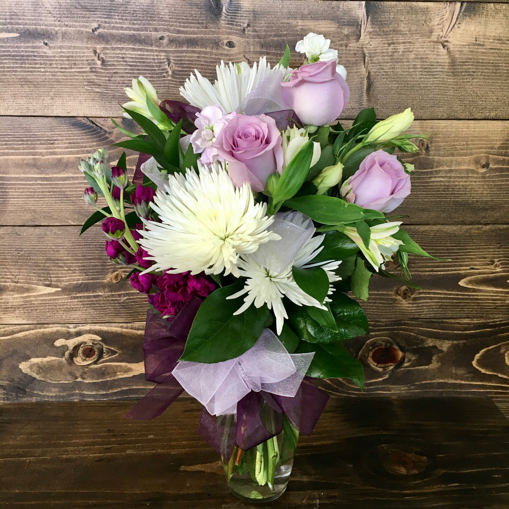 purple rose flower arrangement