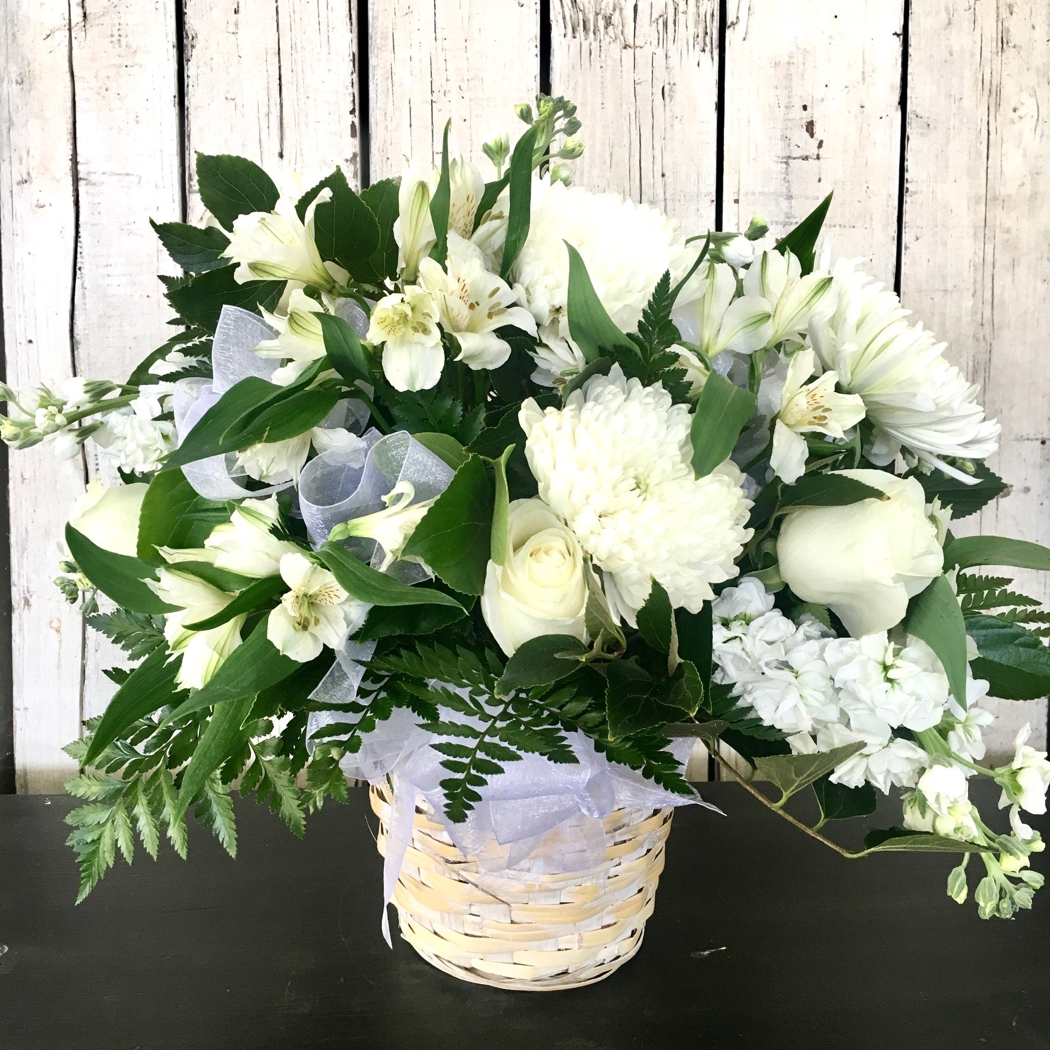 white funeral basket arrangement