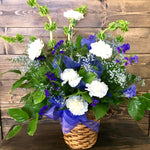 white and blue funeral basket arrangement