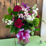 purple spring flower arrangement clovis florist mothers day delivery