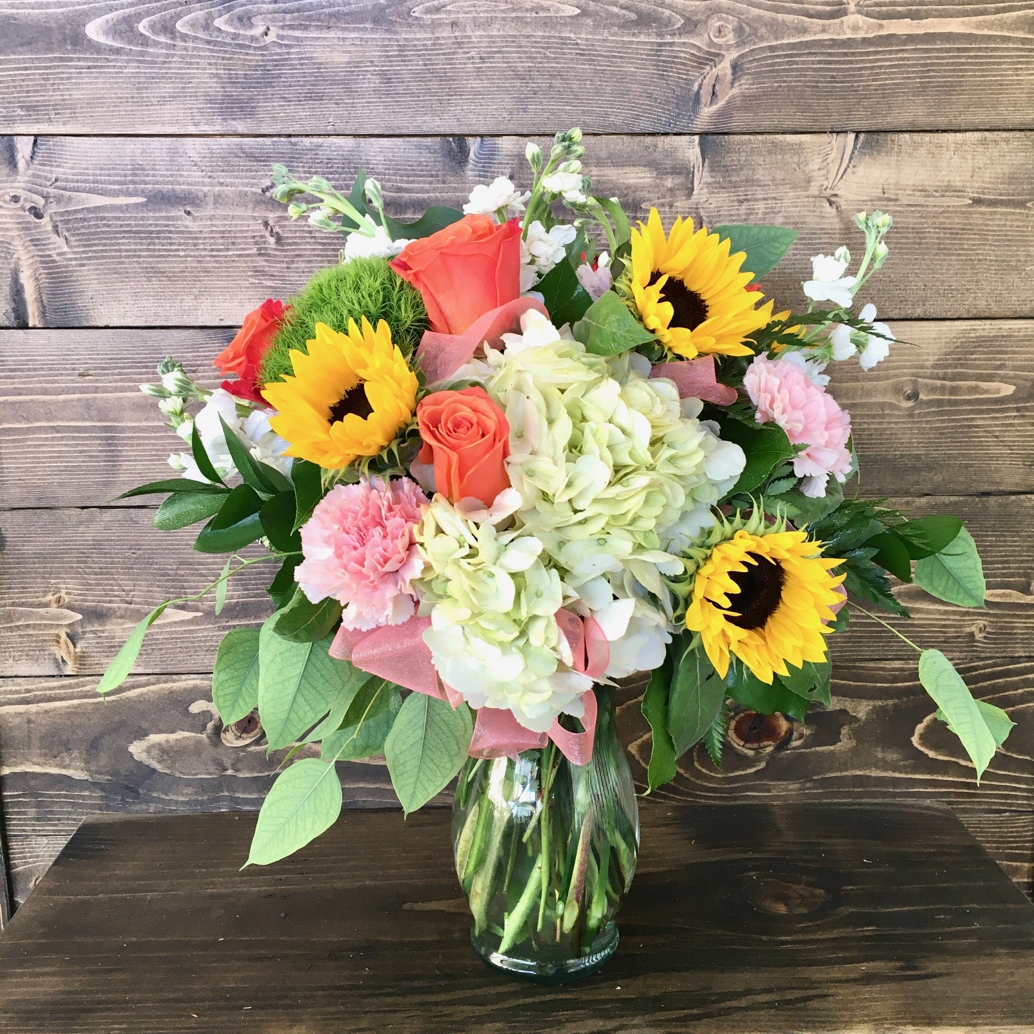 sunflowers roses carnations stock eucalyptus spring arrangement