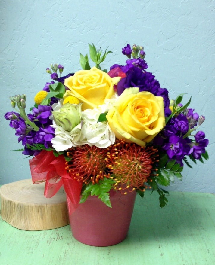 yellow roses purple stock protea flower pot arrangement