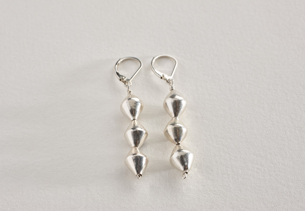 Lawa tribe handcrafted fine silver bicone bead earrings on sterling earwires. Length: 1.5""