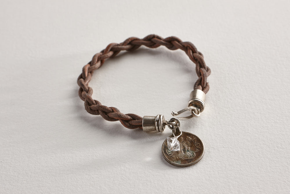 "Handbraided leather bracelet with vintage coin, Herkimer ""diamond"" (pure energy) and Lawa tribe fine silver clasp.  Length: 7"""