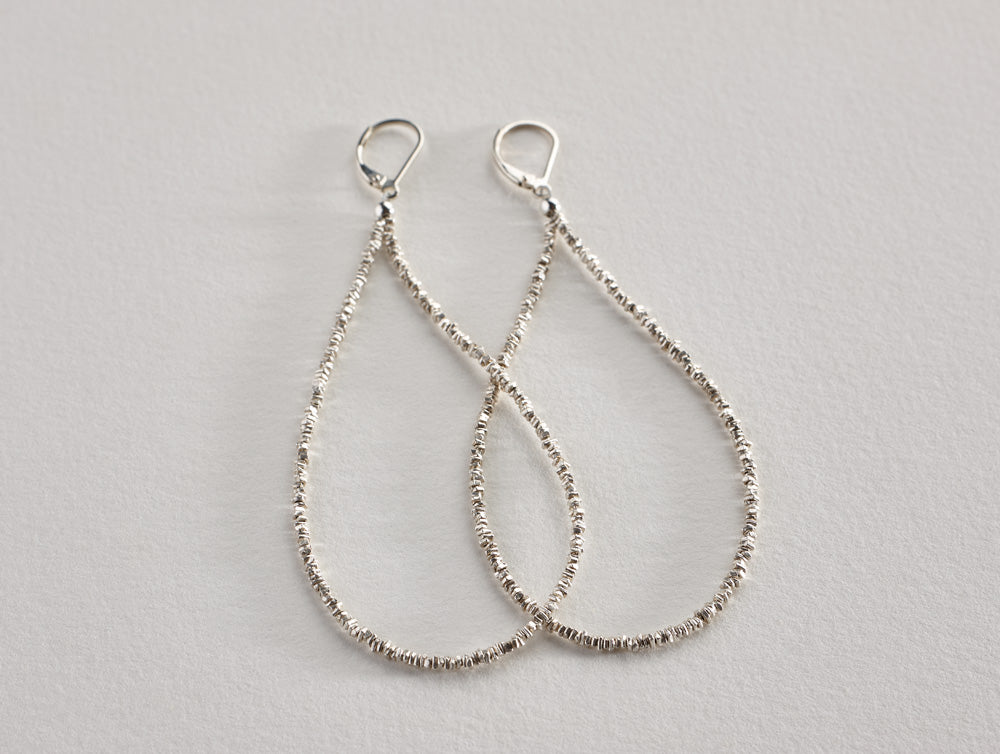 "Gorgeous earrings featuring fine silver heishi beads on sterling silver earwires. Available in two lengths.     Length: 2.3"" or 3"""