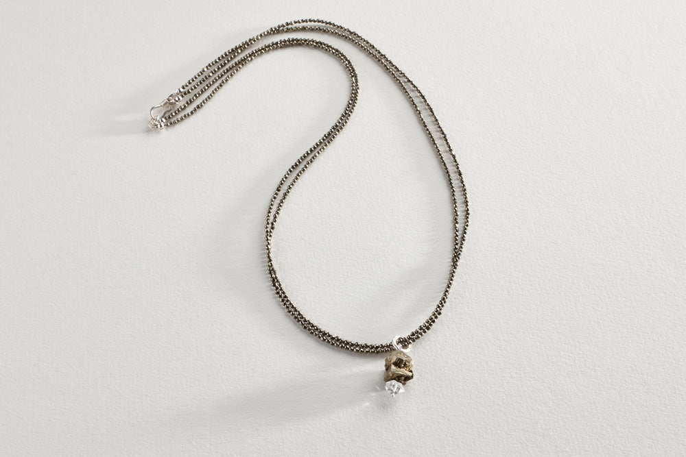 "Double faceted pyrite (creativity and confidence) with rough-cut pyrite nugget and Herkimer ""diamond"" (pure energy) with Lawa tribe fine silver clasp.     Length: 23"""