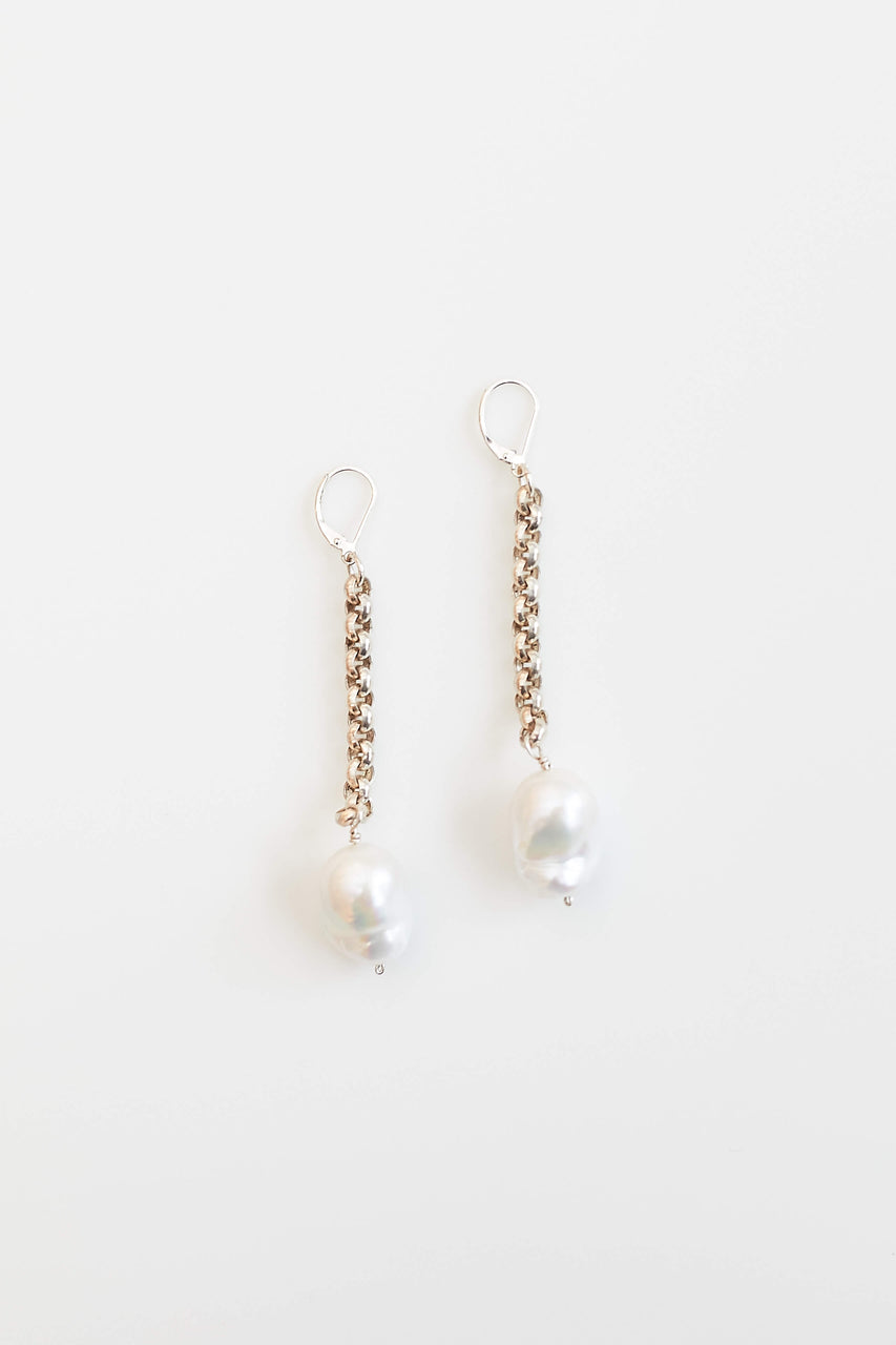 Freshwater pearls (truth and sincerity) on Lawa Tribe handcrafted fine silver earrings.  Length: 3""