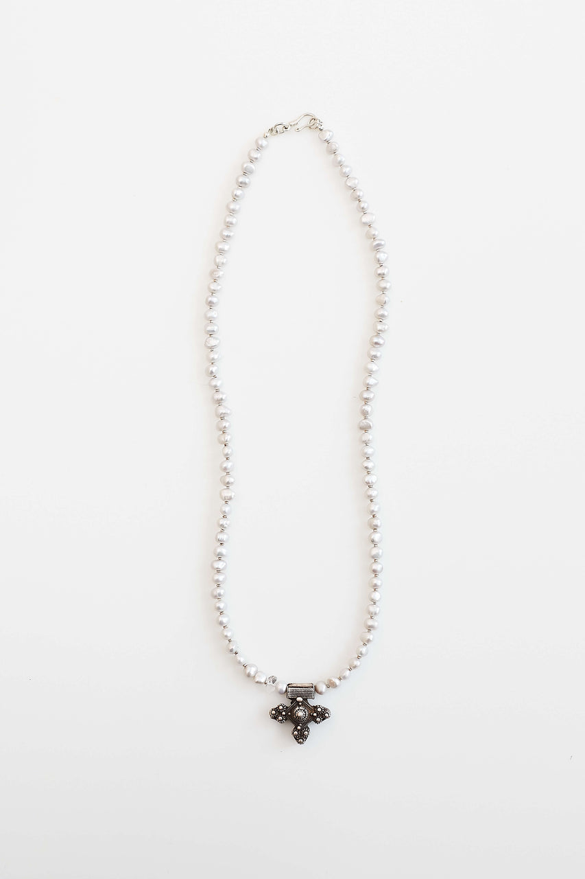 "Freshwater pearls (truth and security), fine silver beads and clasp, vintage Moroccan Cross, Herkimer ""diamond"" (pure energy).  Length: 21"""