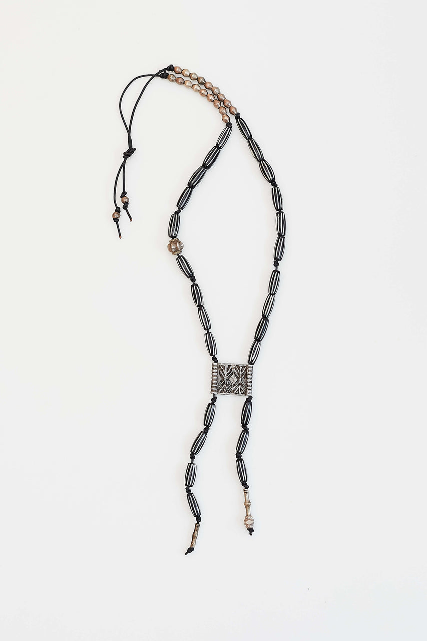 Black African bone beads, vintage belt piece, Tuareg Tribe and Afghan beads.  Length: 20""