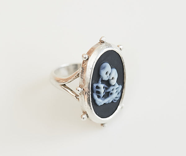The Love Cameo Ring is one-of-a-kind and the first piece from our new Humanity Collection. Two carved white agate skeletons are shown in an embrace against a black agate background. The relevance of skeletons here is to depict human beings without gender, race, religion, etc. We are all equal and deserve respect.  The ring and setting are handcrafted by the Thai Lawa hill tribe in fine silver.  Available in sizes 6, 7 and 8.