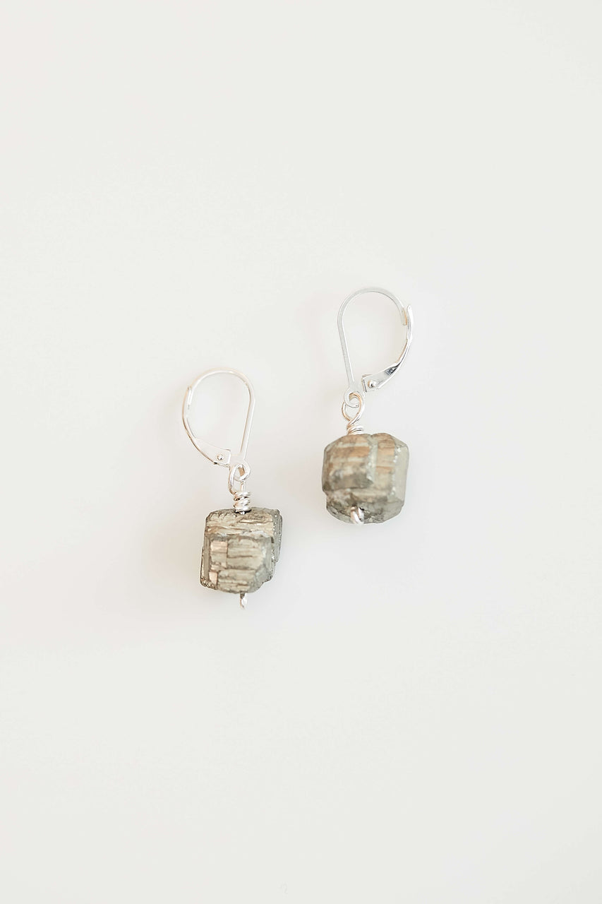Pyrite is known to increase positive action, vitality, willpower, creativity and confidence. Here Pyrite nuggets are paired with sterling silver wires to create versatile earrings.     Length: 1""