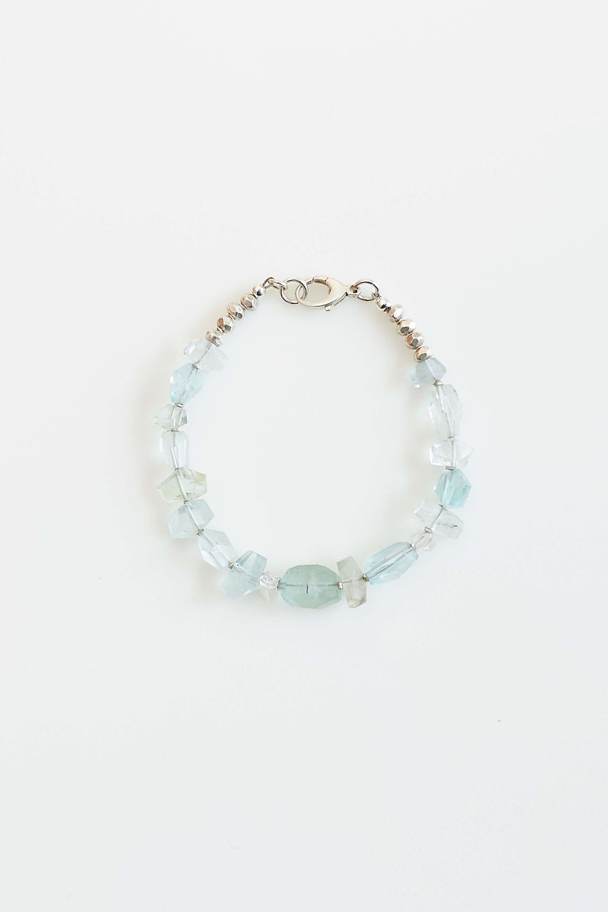"Hand cut faceted aquamarine (calming), Lawa Tribe fine silver beads, sterling clasp and Herkimer ""diamond"" (pure energy)  Length: 7"""