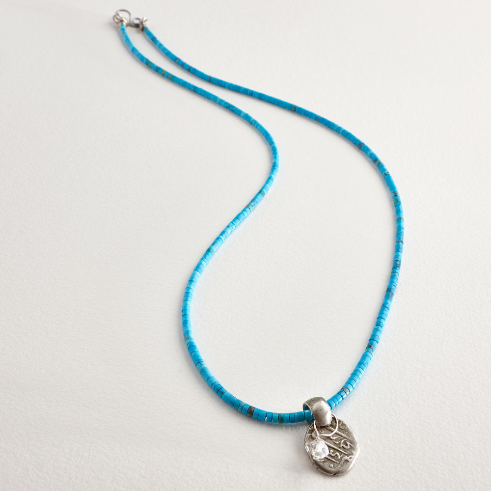 "Matte heishi turquoise (peace and protection) with vintage Moroccan coin and Herkimer ""diamond"" (pure energy).  Length: 25"""