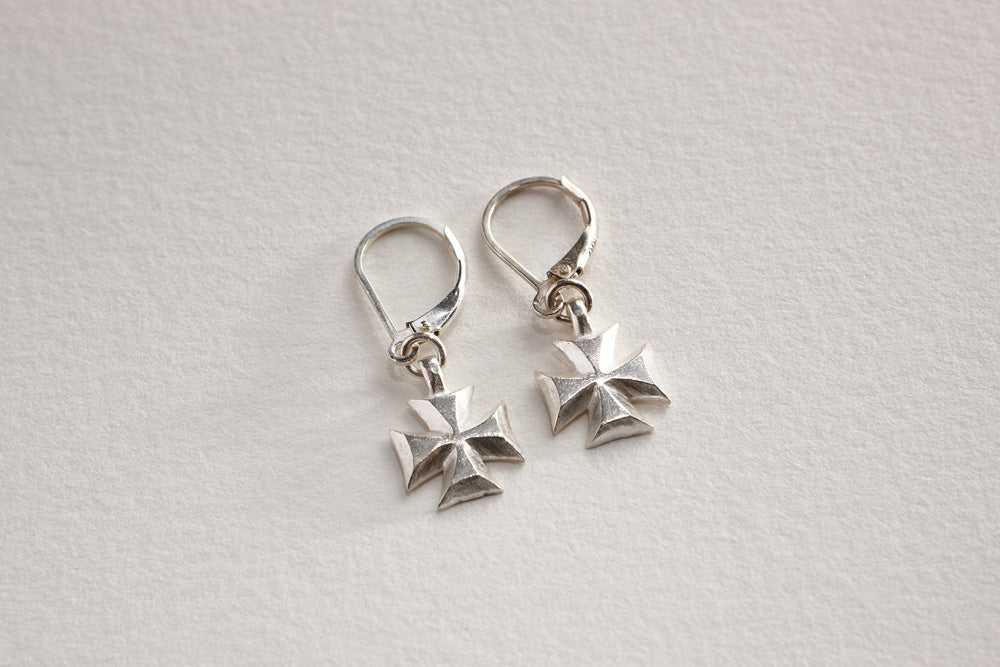 Lawa tribe handcrafted fine silver crosses on sterling silver earwigs.     Length: 5/8""