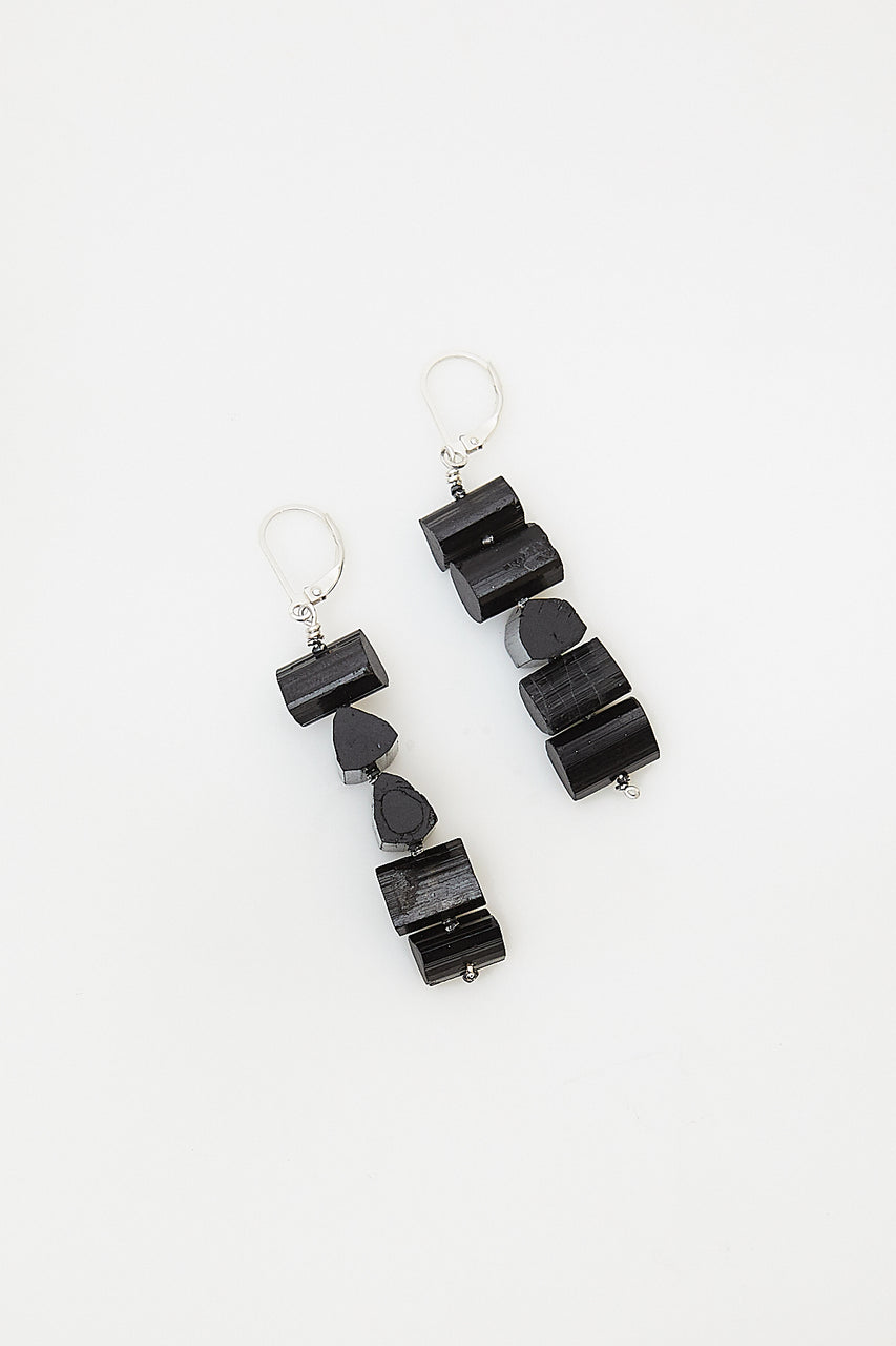 Stacks of black tourmaline on sterling silver earwires provide protection and purification.  Length: 2""