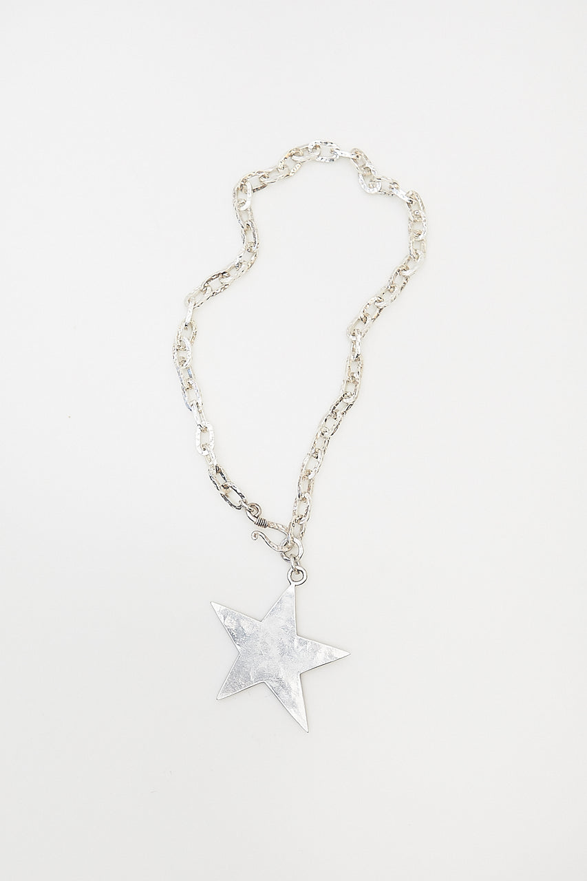 Denise created a stunning star pendant with Lawa Tribe handcrafted, silver hammered chain and clasp.  Length: 19""