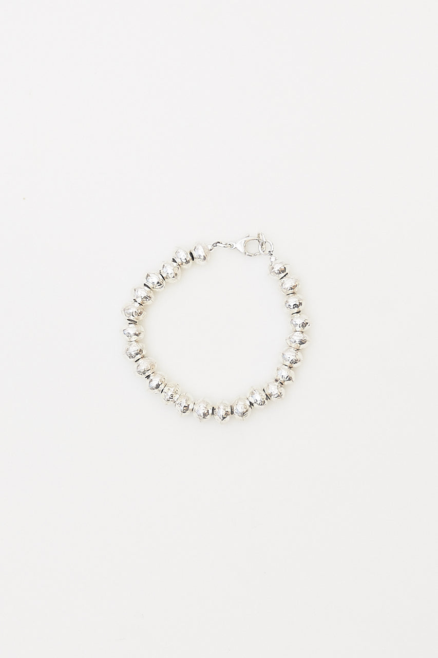 The Emma bracelet features handcrafted fine silver beads and clasp from a Lawa Hill Tribe in rural northern Thailand.  Length: 7""
