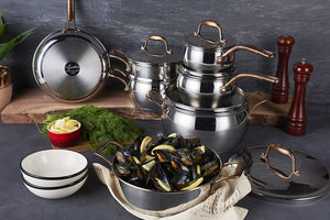 The Bronze Elegance 12-Piece Cookware Set makes a statement – both on and off the stove. The thick aluminum base provides fast heat transfer, encapsulated by premium stainless steel for improved heat retention and fast, effortless cooking. The contrasting bronze handles provide optimum durability and style.