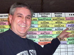 Jeff Peters in front of a fantasy football draft board