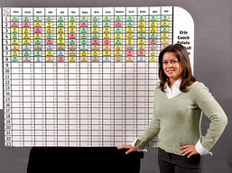 Lynn Peters in front of a jumbo draft board