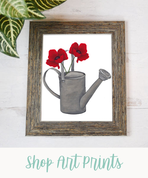 """poppy flowers in a watering can wall art print with text """"shop art prints"""