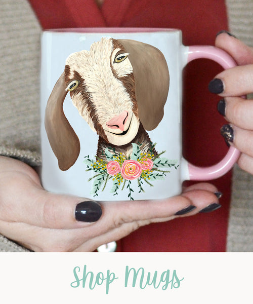 """happy brown and white goat with pink flowers coffee mug with text """"shop mugs"""""""