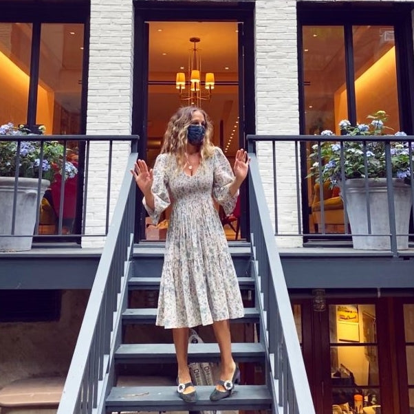 Sarah Jessica Parker Greets Customers in Sparkly Pumps & Floral Face Mask At Her New Store
