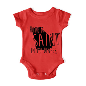 I HAVE A SAINT IN MY DIAPER Baby One Piece