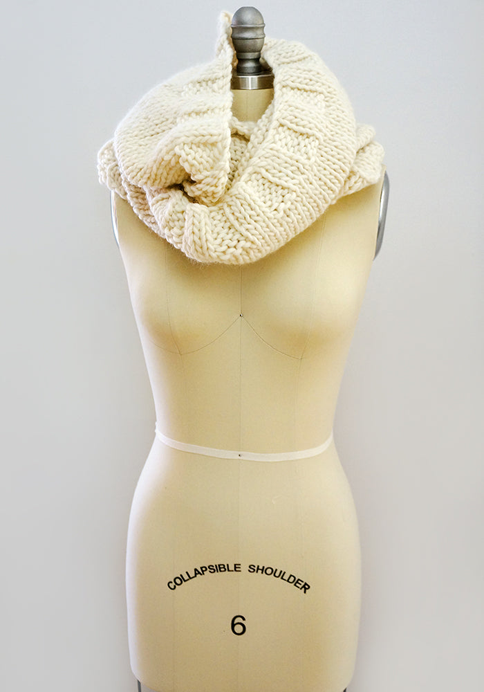 Knitted wool infinity scarf worn as a cowl