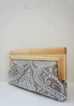 Linen Damask print fabric with  natural wood frame clutch side