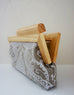 Linen Damask print fabric with  natural wood frame clutch open