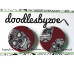 25mm studs in the pattern burgundy skulls