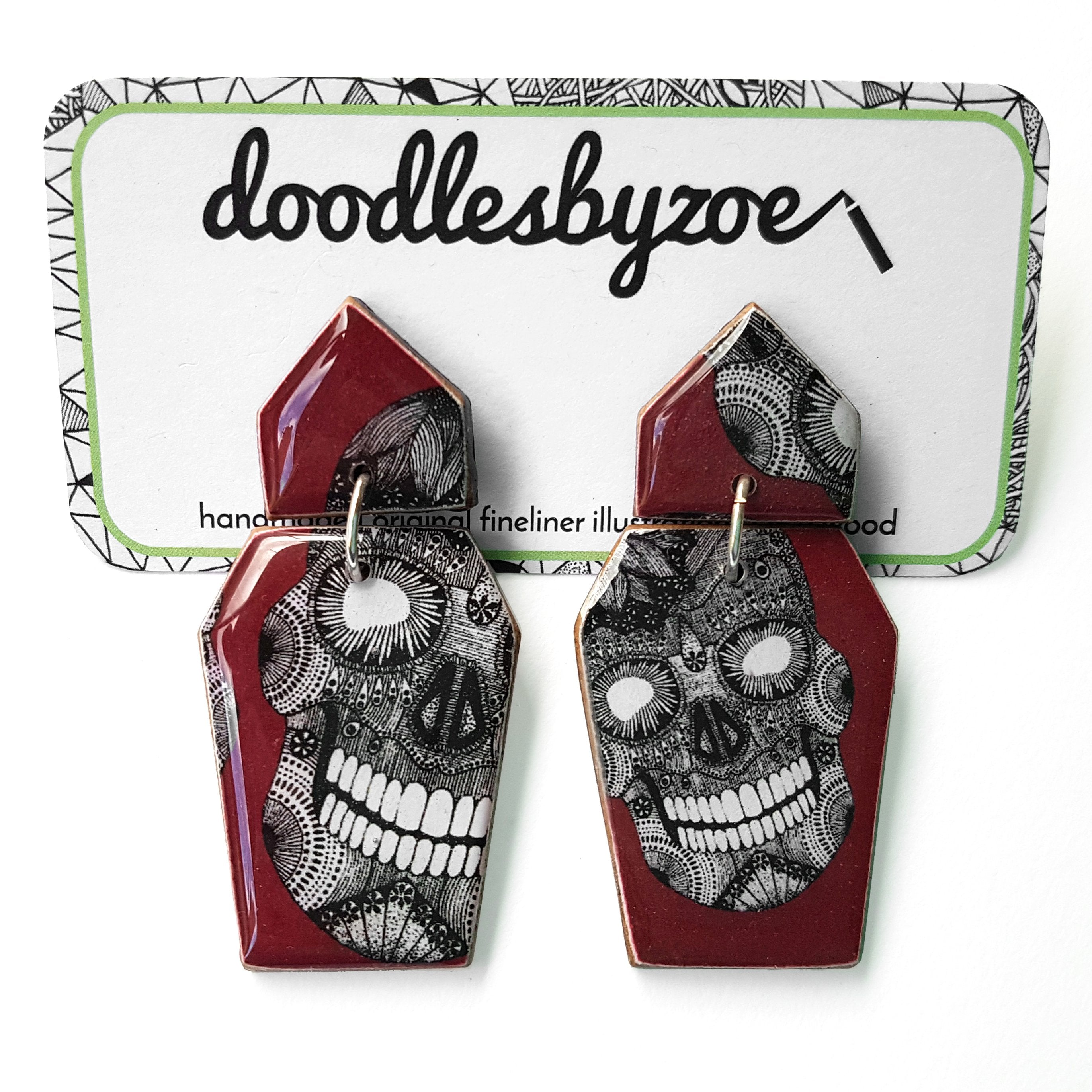 Coffin shaped earrings in the pattern burgundy skulls
