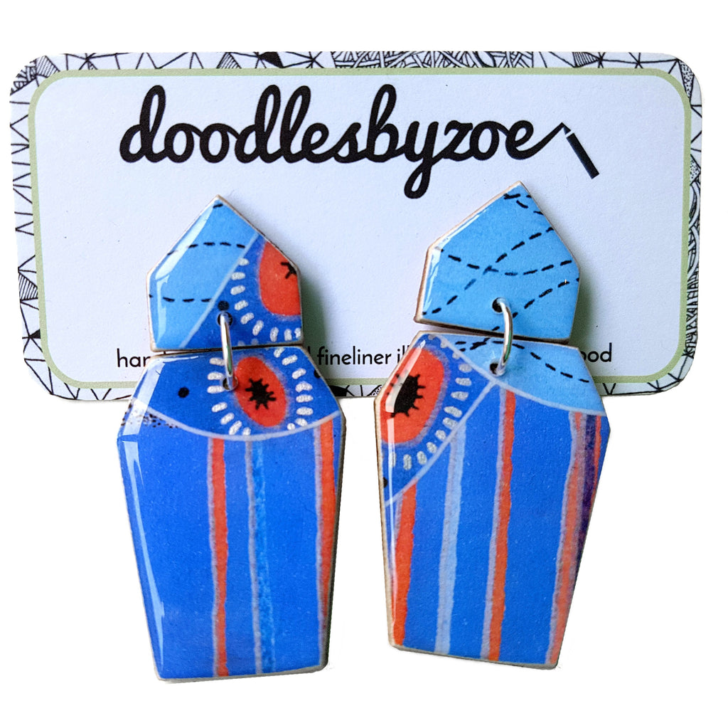 Coffin shaped earrings in the pattern tall poppy blue