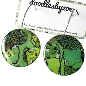 large disc earrings in the pattern greenery