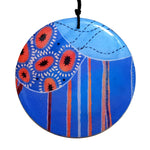 disc pendant necklace in the pattern tall poppy blue