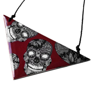 triangle pendant necklace in the pattern burgundy skulls