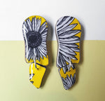 wavy dangle earrings in the pattern yellow daisy
