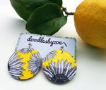 large disc earrings in the pattern yellow daisy