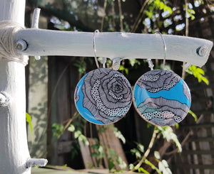large disc earrings in the pattern aqua rose