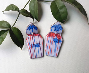 Coffin shaped earrings in the pattern tall poppy white