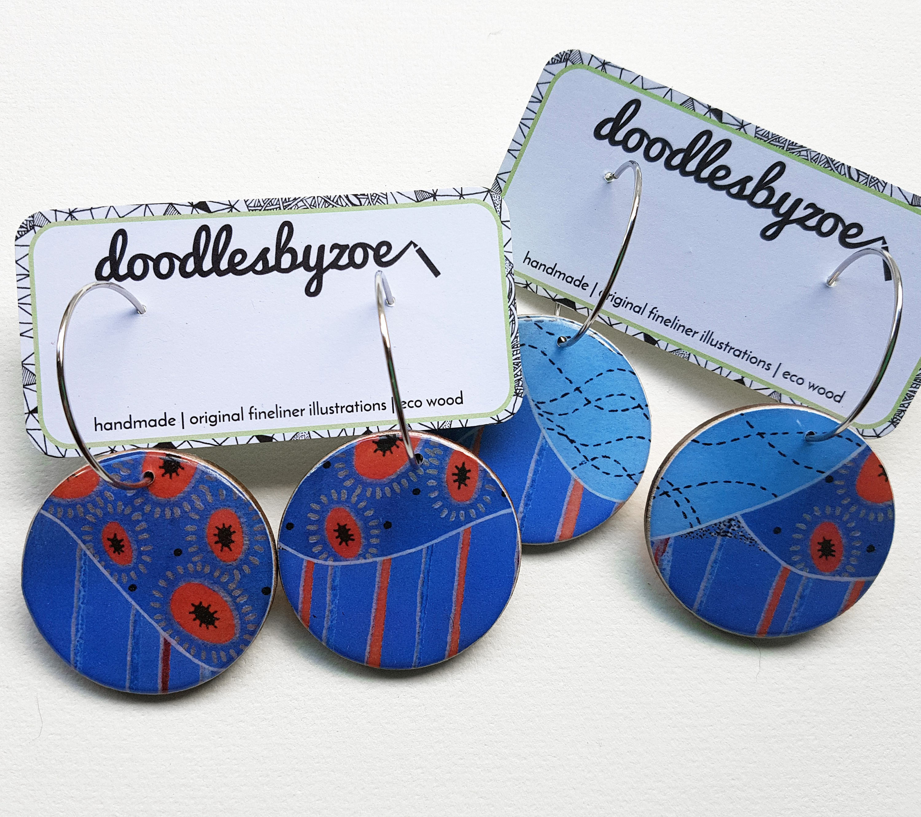 large disc earrings in the pattern tall poppy blue