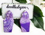 Coffin shaped earrings in the pattern purple haze