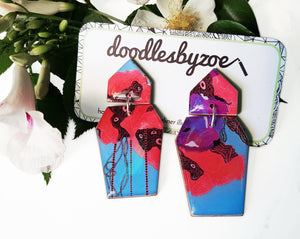 Coffin shaped earrings in the pattern purple & red blooms
