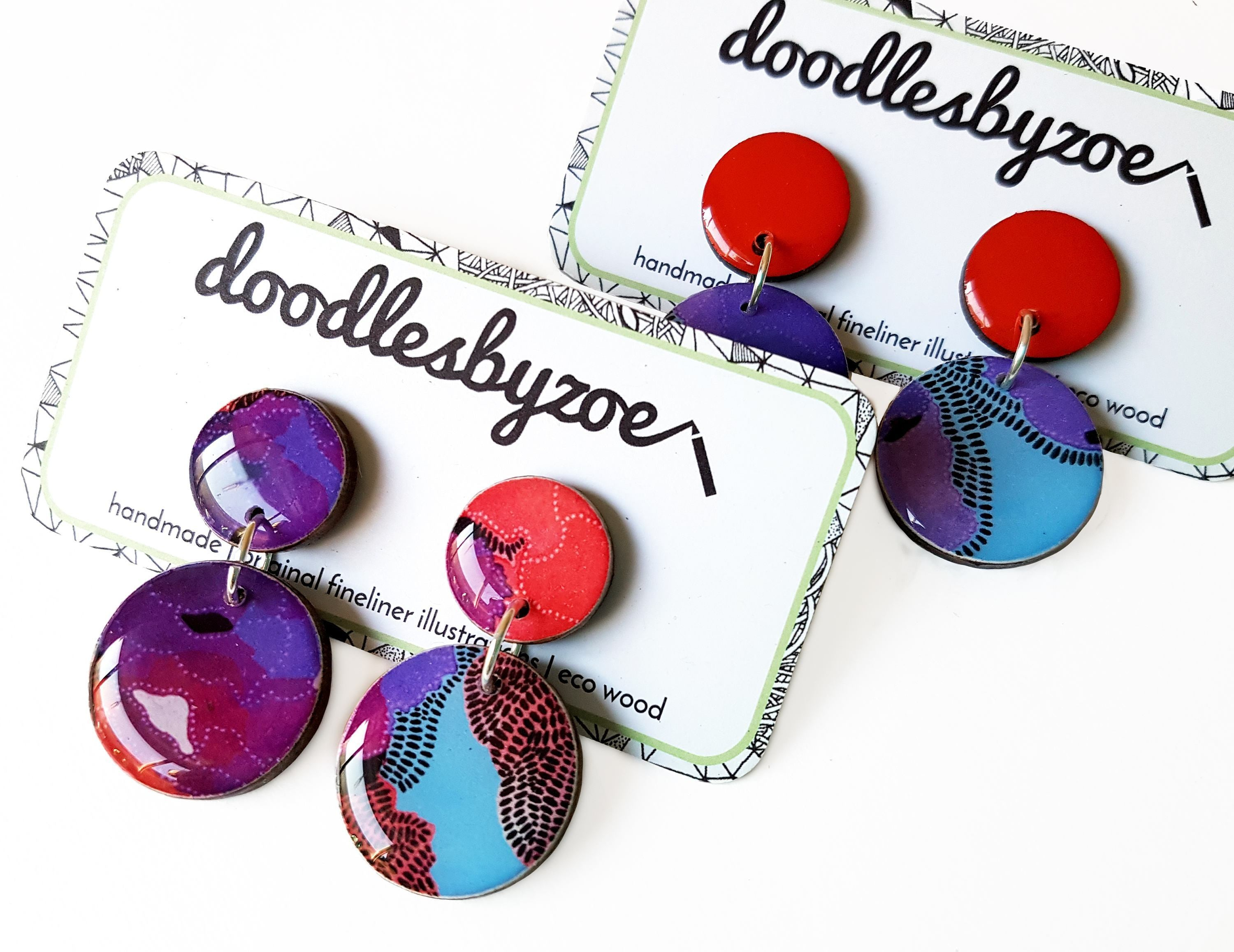 double circle drop earrings in the pattern purple & red blooms