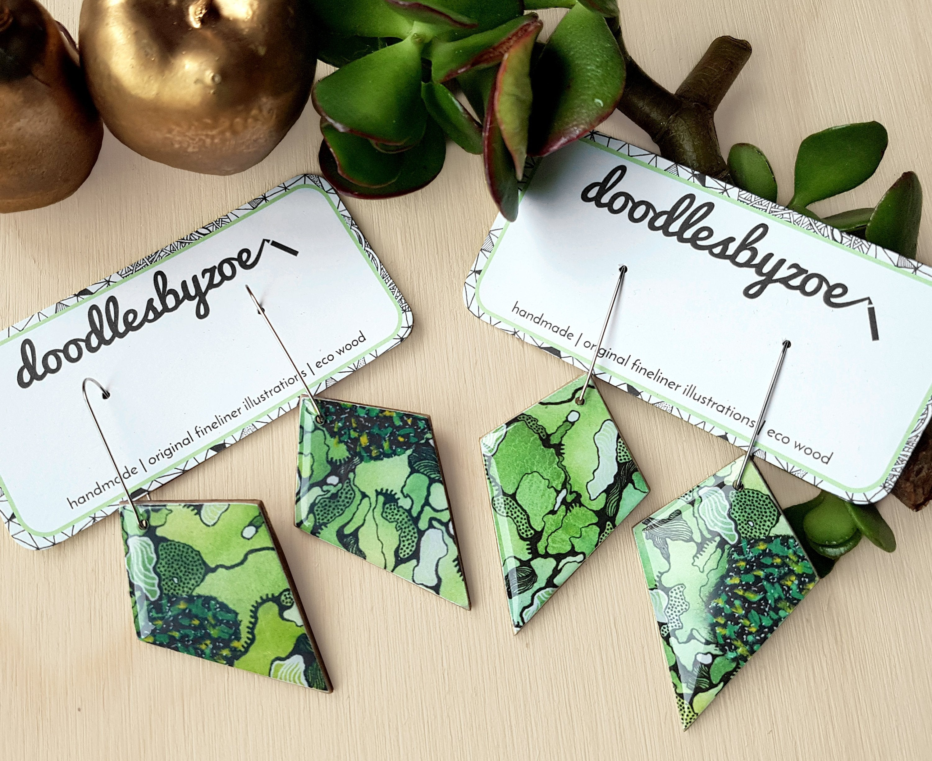 diamond dangle earrings in the pattern greenery